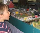 kid watching trains at model railway show